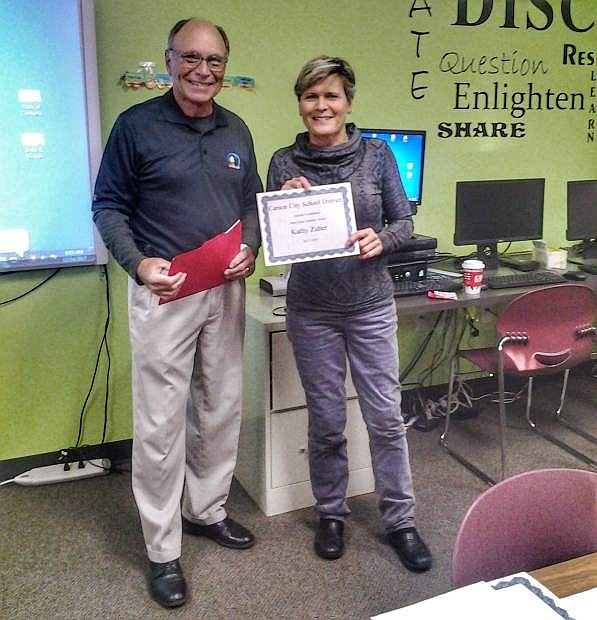 Keith Squires, CCSF board member and retired school administrator, awarding the mini-grant certificate to Kathy Zuber, fourth grade teacher at Bordewich Bray Elementary.