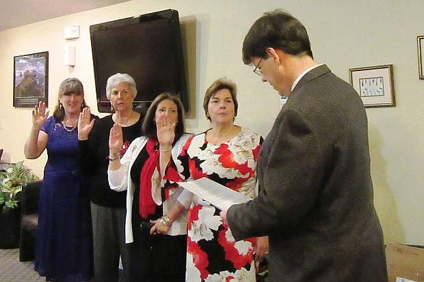 The Honorable Judge Leon Aberasturi administered the Oath of Office to incoming officers at the Fernley Republican Women annual Christmas/Installation Dinner on Dec. 16 at The Golf Club at Fernley. The officers for 2018 are Lorrie Olson, President; MJ Dodson, 1st Vice President; Joy Connelly, 2nd Vice President; Peggy Gray, Secretary; and Kim Bussey-Paxton, Treasurer. Pictured from left: Kim Bussey-Paxton, Peggy Gray, MJ Dodson, Lorrie Olson and Judge Leon Aberasturi. For information, email Lorrie Olson at llflolson3@yahoo.com, or go to fernleyrepublicanwomen.com.