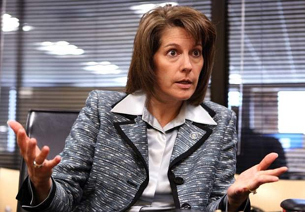 FILE - In this Sept. 24, 2012 file photo, Nevada Attorney Gen. Catherine Cortez Masto speaks to an editorial board at the Las Vegas Sun offices in Henderson, Nev. Masto announced Wednesday, April 8, 2015, that she will run for Harry Reid's Senate seat in 2016. She says she left her new job as the executive vice chancellor for the Nevada System of Higher Education on Tuesday to launch her campaign. (AP Photo/The Las Vegas Sun, Leila Navidi,File) LAS VEGAS REVIEW-JOURNAL OUT