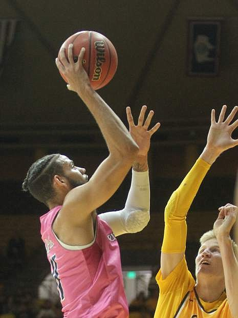 Nevada forward Cody Martin (11) shoots over Wyoming forward Hayden Dalton (20) during the first half of an NCAA college basketball game in Laramie, Wyo., Wednesday, Jan. 24, 2018. (Shannon Broderick/Laramie Boomerang via AP)