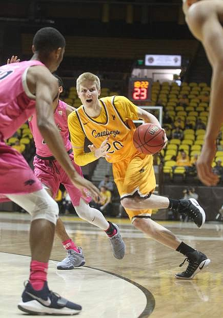 Wyoming forward Hayden Dalton (20) drives against Nevada during the first half of an NCAA college basketball game in Laramie, Wyo., Wednesday, Jan. 24, 2018. (Shannon Broderick/Laramie Boomerang via AP)