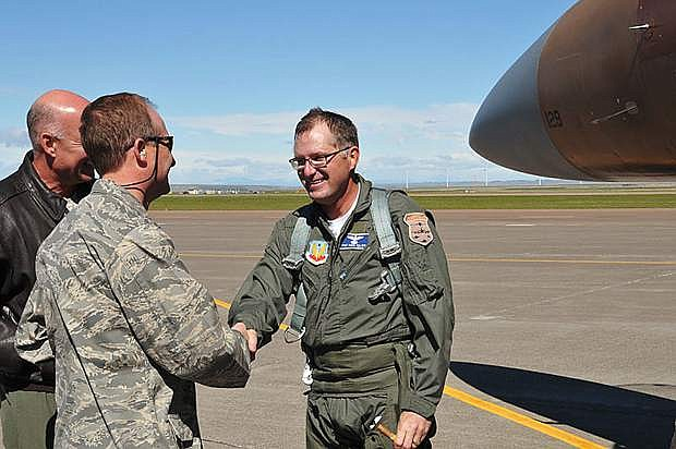 Author Dave Pelzer greets Lt Col. Carlton and Col Hronek after a flight with the Montana Air National Guard 120th Fighter Wing.