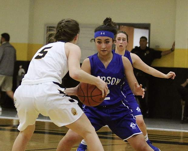 Carson's Lilian Bouza guards Galena's Kristin Farrell during Tuesday's game at Galena.