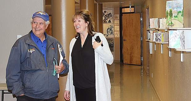 Rick Lattin, left, of Lattin Farms attends an open house at the college with WNC Director Sherry Black.