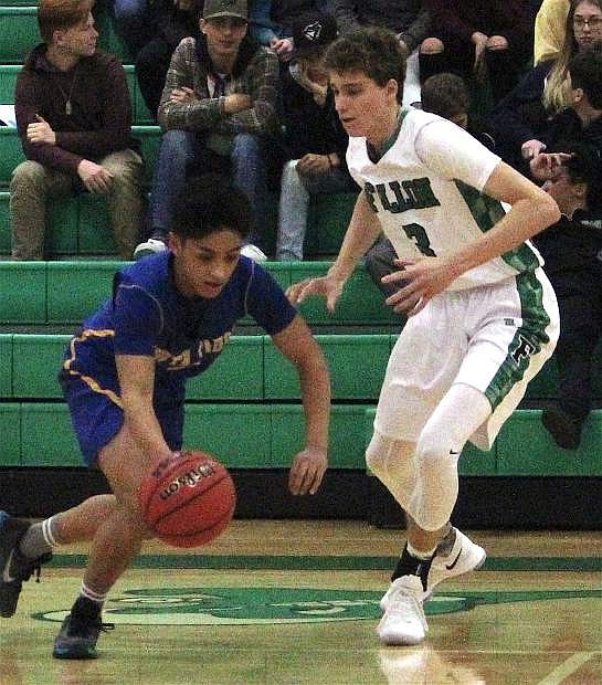 Fallon's Hayden Strasdin races a South Tahoe player to grab the ball during Saturday's Fallon home game.