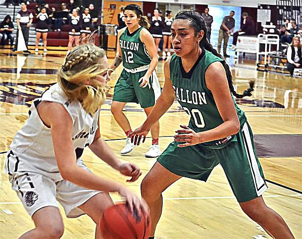 Fallon's Lailani Otuafi guards against a shot from one of Elko's players during the Wave's game in Elko.
