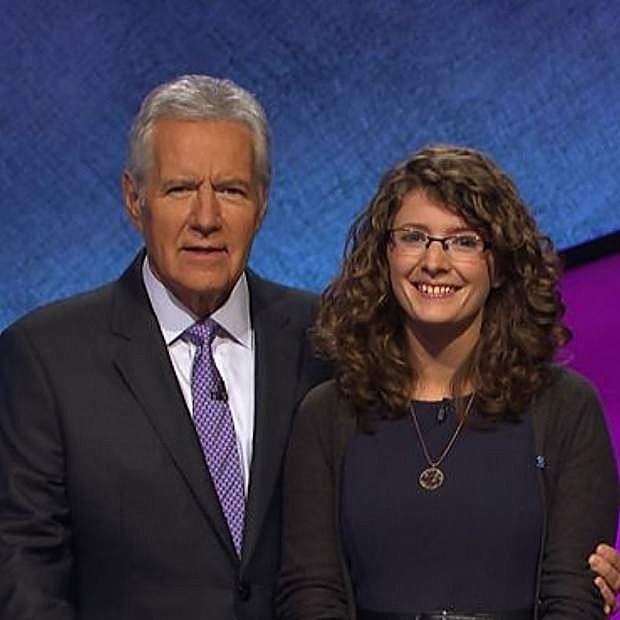 Rachel Lindgren poses with Alex Trebek.
