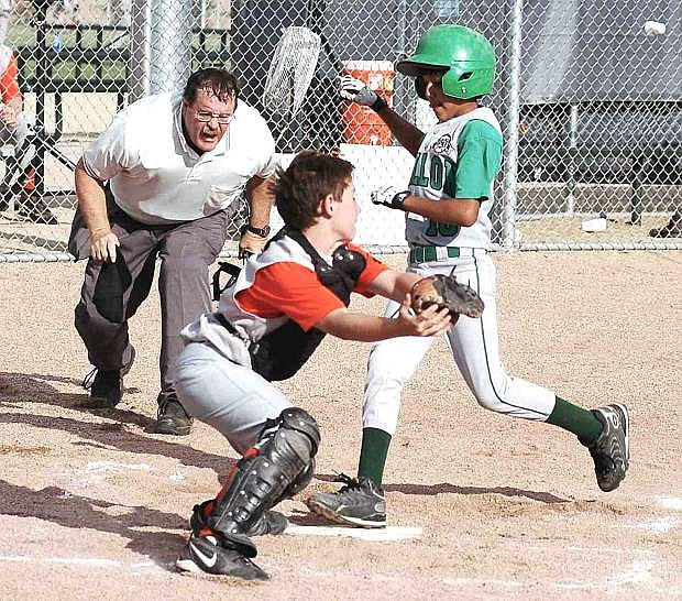 In this file photo, Steve Ranson calls Fallon's Wyatt Tuni safe during a State Cal Ripken game youth baseball game.