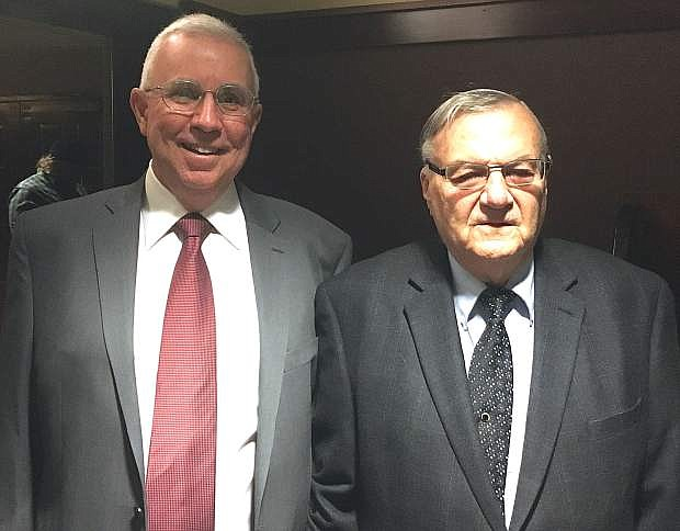 Richard Schwabe, left, chairman of the Douglas County Central Republican Committee stands next to former Arizona Sheriff Joe Arpaio.
