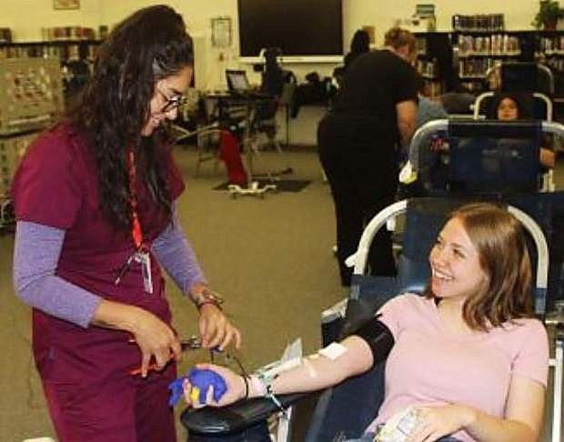 United Blood Service technician Raelena Valenzuela, left, prepares Churchill County High School student Angelina Mattern to give blood Oct. 5, 2017, days after the Route 91 festival shooing in Las Vegas.