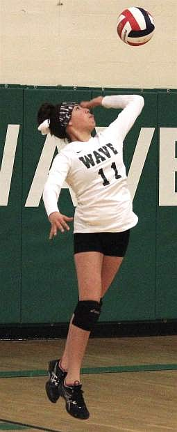 Fallon's Sadoni Downs leaps for a serve against Coral Academy Wednesday.