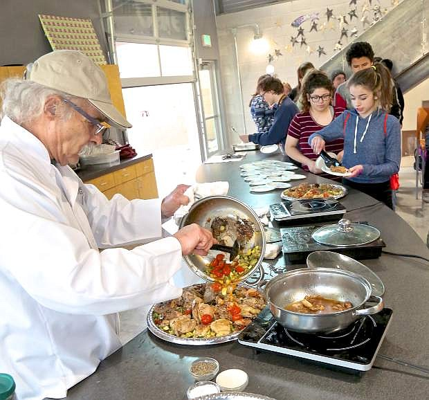 Celebrity chef Charlie Abowd of Adele's prepares crunchy chicken thighs with zucchini at the Boys & Girls Clubs of Western Nevada.