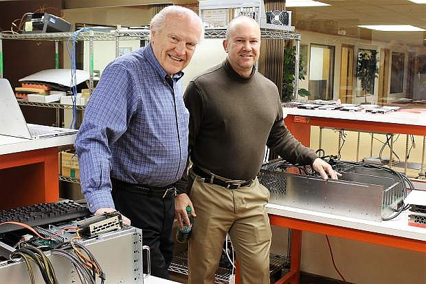 Cubix owner Al Fiegehen (left) and son Eric are creating the next generation of high-speed computers used in artificial intelligence.