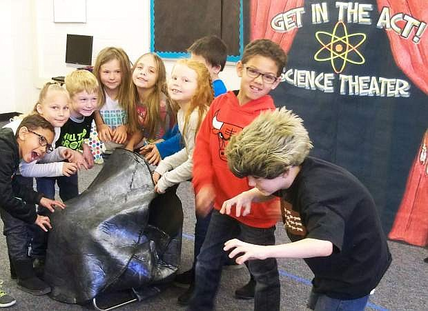 Second graders from E.C. Best School in Fallon act out scenes while learning science concepts at a science theater program held in January.