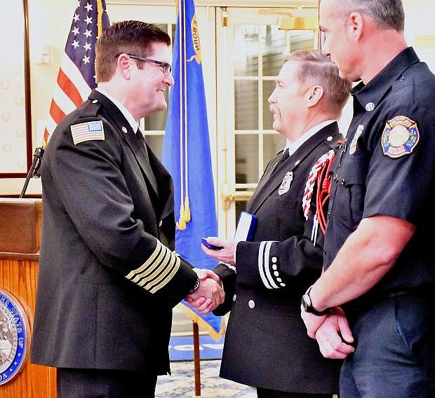 Fire Chief Sean Slamon gives the Life Saving Award to Capt. Dan Albee during the End of the Year Awards banquet.