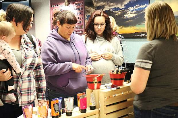 Friends and families attend Banner Churchill Community Hospital for the annual Ladies Night Out on Thursday, to shop for clothing, jewelry and more.
