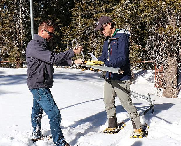 Truckee Meadows Water Authority Senior Hydrologist Bill Hauck, and Jeff Anderson of Nevada Resources Conservation Service, right, conduct monthly snowpack measurements Feb. 5 at Mount Rose summit.