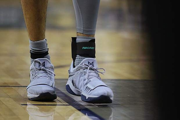 Caleb Martin's wore a brace on his injured foot Saturday against San Diego State.