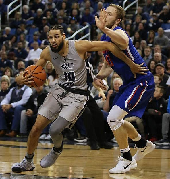 Nevada's Caleb Martin tries to drive around a Boise State player in the second half on Saturday.