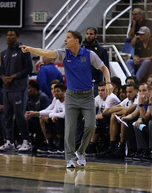 Nevada coach Eric Musselman directs his defense against UNLV during Wednesday's 86-78 loss.