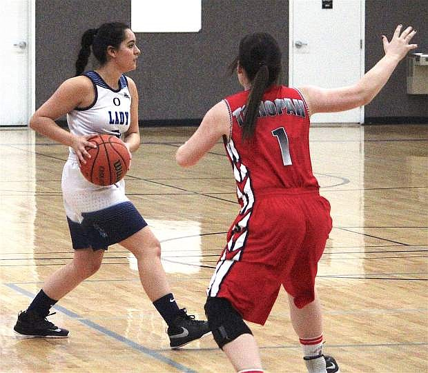 Oasis Academy's Mariah Snooks looks for an opening to pass the ball as Tonopah's Tessa North blocks her.