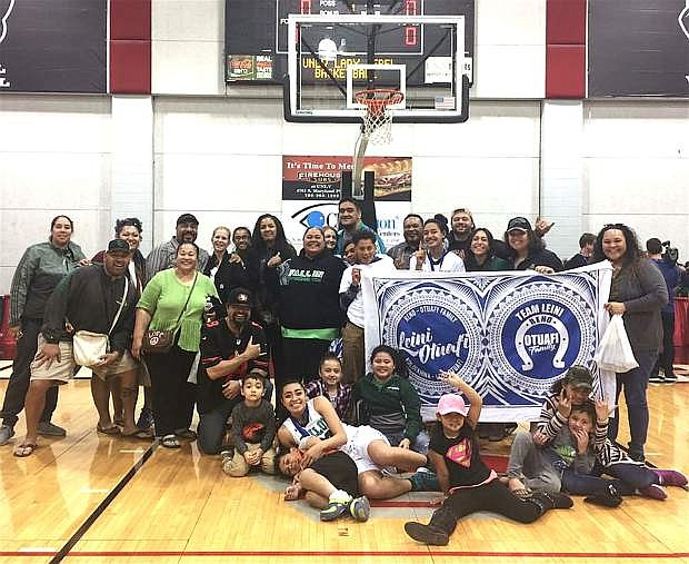 The Otuafi family surrounds Fallon juniors and cousins Leilani and Leta Otuafi after last year's state championship win in Las Vegas.