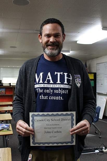 Pioneer High School teacher John Corbitt earned a mini-grant that will help fund a science rocketry program at the school.