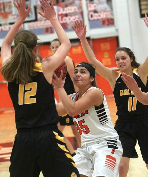 Karla Sanchez of Douglas is surrounded by Galena defenders in Tuesday's game at Douglas. Galena won, 57-42.