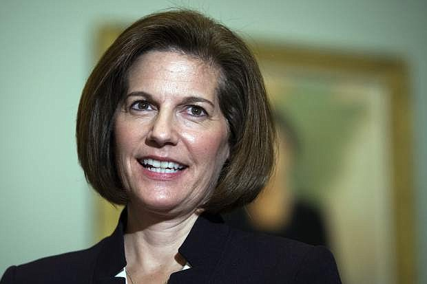 FILE - In this Nov. 14, 2016 file photo, Catherine Cortez Masto, D-Nev., speaks with reporters on Capitol Hill in Washington after being elected to the U.S. Senate. Cortez Masto was sworn in Tuesday, Jan. 3, 2017, becoming Nevada's first female in the upper chamber of Congress and the nation's first Latina senator. (AP Photo/Cliff Owen, File)
