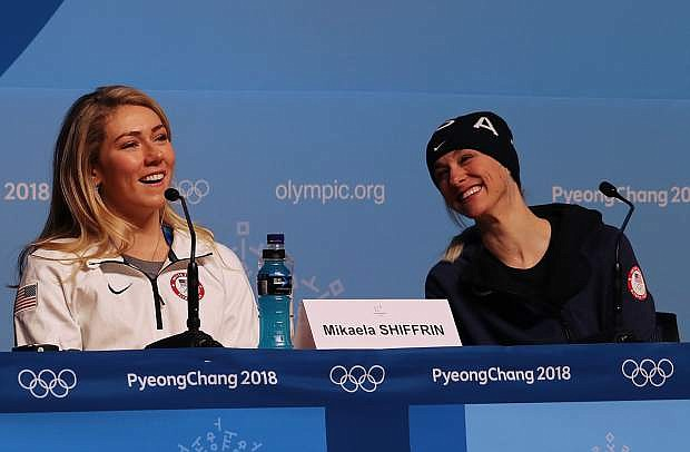 Mikaela Shiffrin, left, with U.S. Team press officer Megan Harrod, speaks to the media Saturday, Feb. 10, at the Main Press Center in Pyeongchang, South Korea, as she prepares to compete in the Winter Olympics.