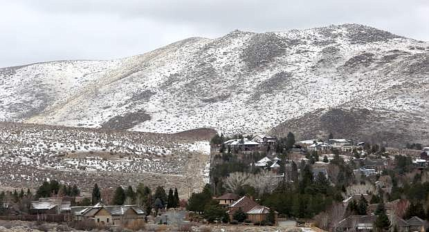 A dusting of snow covers the foothills around Carson City on Monday morning.