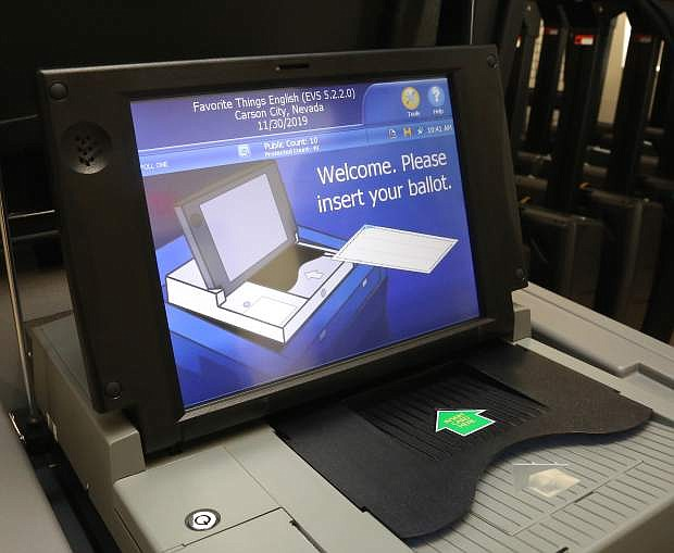 Carson City voters will insert their paper ballots into an electronic ballot box after casting their votes using the new ballot marking device.