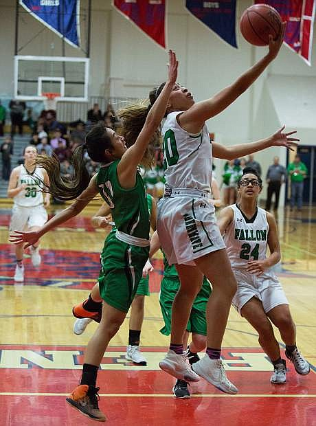 Fallon's Leilani Otuafi led both teams in scoring with 18 points as the Lady Wave advanced to the state championship game.