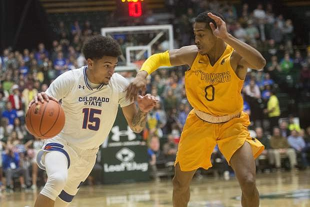 Colorado State guard Anthony Bonner drives the ball around Wyoming guard Nyaires Redding during an NCAA college basketball game Wednesday, Jan. 31, 2018, in Fort Collins, Colo. (Austin Humphreys/The Coloradoan via AP)
