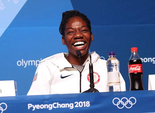 U.S. Olympic short track speedskater Maame Biney laughs during a news conference on Wednesday, Feb. 7, at the Main Press Center of the Pyeongchang Winter Olympics in Pyeongchang, South Korea.
