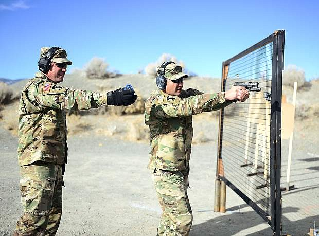 Master Sgt. Michael Clark, right, receives instruction from Maj. Robert Kolvet during a mock final shooting test for Nevada National Guard unit marshal applicants in December 2017 at a shooting range near Carson City, Nev. The Unit Marshal Program allows Guardsmen to carry their personally owned firearms concealed while on Nevada Guard property as a deterrent to active assailants and insider threats.