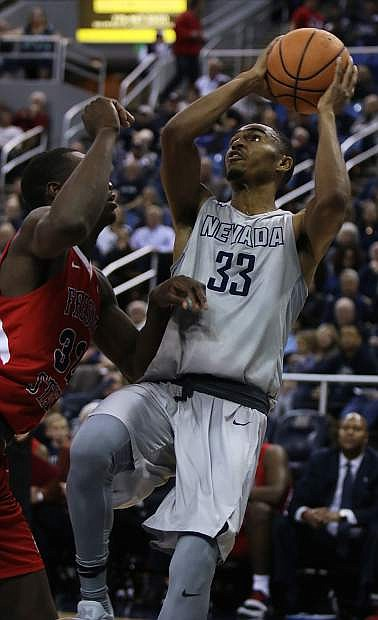 Josh Hall takes a fadeaway jumper for Nevada recently against Fresno State.