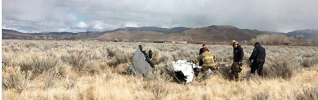 Authorities look over the wreckage of a plane crash on Monday.