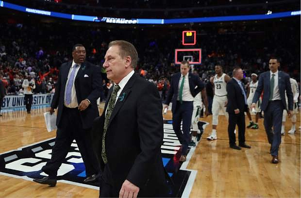 Michigan State head coach Tom Izzo walks off the court after the team lost to Syracuse in a second-round game in the NCAA college basketball tournament, Sunday, March 18, 2018, in Detroit. (AP Photo/Carlos Osorio)
