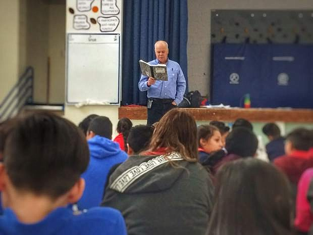 Gary Hogg teaches students at Empire Elementary about writing and storytelling on Monday.
