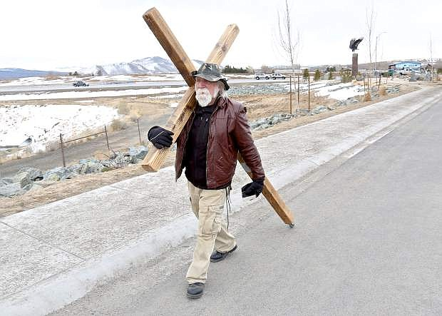 Wes Mauch of Lake Matthews, Calif. heads north on S. Carson St. with his cross Wednesday morning.