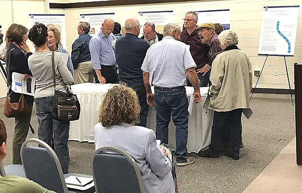 About 100 people attended a Nevada Department of Transportation public information meeting to discuss plans for the Interstate 11 corridor between Las Vegas and Reno.