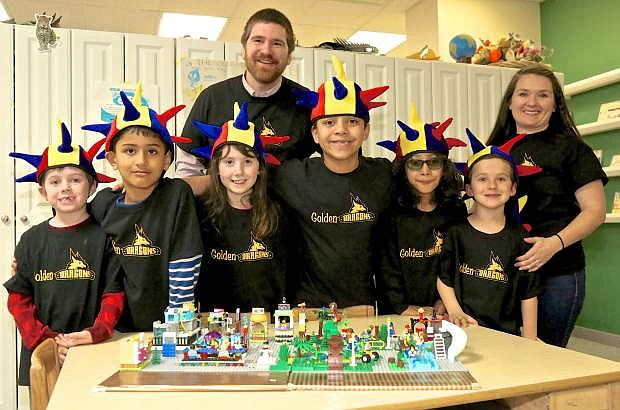 The Lego Robotics 'Golden Dragons' pose for a photo Thursday at Carson City Montessori. They are: Jackson Isom, 7, Sujwal Yedunuthula, 7, Shaylee Erickson, 8, Jordyn Montogmery, 8, Ethan Suarez, 8, and Gavin Andree, 7. Also pictured are coaches Marco Erickson and Tonia Andree.