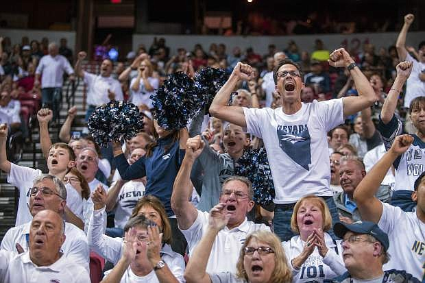 Nevada fans sing and celebrate as their team leads UNLV during the second half of an NCAA college basketball game in the quarterfinals of the Mountain West tournament Thursday in Las Vegas.