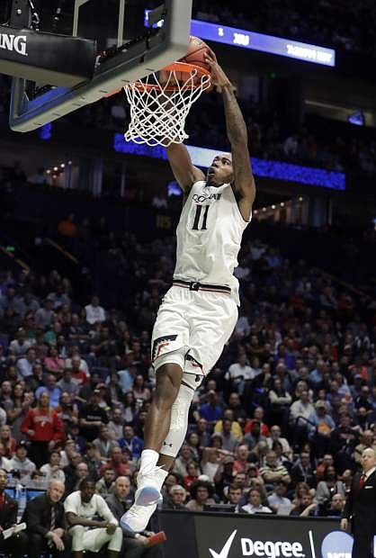 Cincinnati forward Gary Clark (11) dunks in the second half of Friday's game against Georgia State.