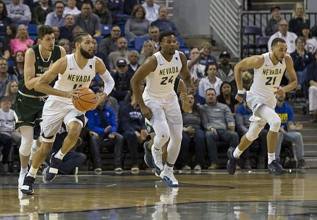 Nevada's Cody Martin, left, leads a fast break against Colorado State on Feb. 25. The Pack ends the regular season Saturday at San Diego State.