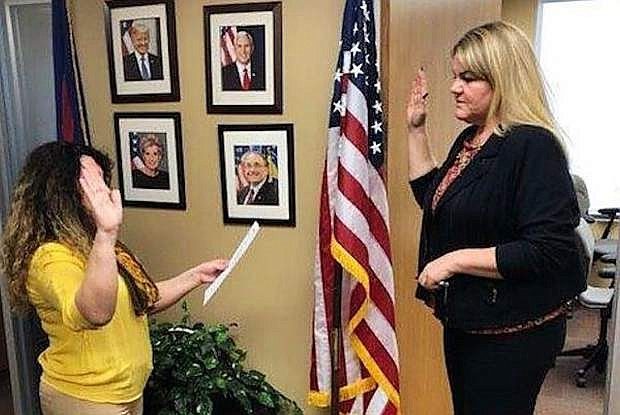 Nevada SBA Administrative Officer Sabrina Abousaleh, left, swears in new Nevada Service Area Manager Rachel Dahl.