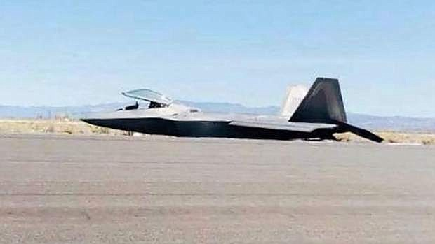 A U.S. Air Force F-22A Raptor sits on its belly after a runway crash Friday at Naval Air Station Fallon.