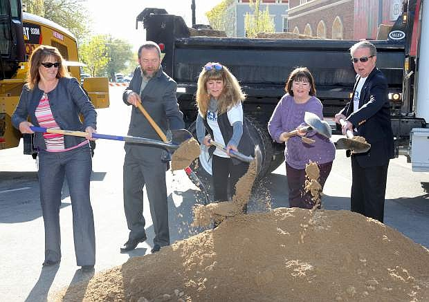 Participating in a ground breaking ceremony for the Downtown Curry Streetscape Project on Monday are, from left, Deputy City Manager Nancy Paulson, Supervisor Brad Bonkowski, Supervisor Karen Abowd, Supervisor Lori Bagwell and Mayor Bob Crowell.