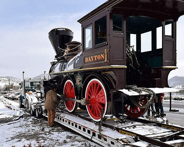 Chris DeWitt, restoration specialist for the Nevada State Railroad Museum in Carson City, checks the tie-downs as the historic 1873 V&T Railroad locomotive the Dayton is readied for transport from the Comstock History Center in Virginia City to the railroad museum in Carson City on Monday, April 16, 2018. Guy Clifton/Travel Nevada